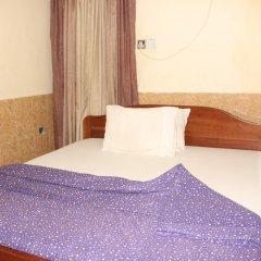 Отель Bv.Standard Executive Suite Нигерия, Калабар - отзывы, цены и фото номеров - забронировать отель Bv.Standard Executive Suite онлайн комната для гостей фото 2
