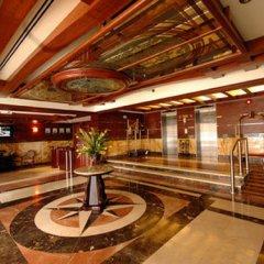 Отель Tulip Inn Sharjah Hotel Apartments ОАЭ, Шарджа - отзывы, цены и фото номеров - забронировать отель Tulip Inn Sharjah Hotel Apartments онлайн интерьер отеля фото 2
