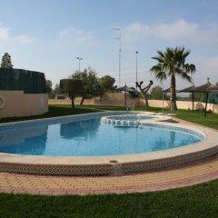 Отель Spanish Family Duplex бассейн
