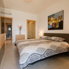 Отель Seafront LUX APT IN Fort Cambridge Мальта, Слима - отзывы, цены и фото номеров - забронировать отель Seafront LUX APT IN Fort Cambridge онлайн комната для гостей