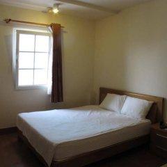 Отель Moonlight Serviced Apartmnet Хошимин комната для гостей фото 2