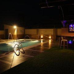 Отель Kiniz Luxury Apartments Нигерия, Уйо - отзывы, цены и фото номеров - забронировать отель Kiniz Luxury Apartments онлайн бассейн