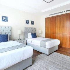 Отель Bright and Luxurious Apt in the Heart of Difc! Дубай комната для гостей фото 2