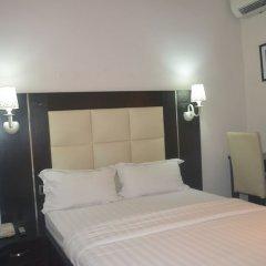 Отель Mac Dove Lounge & Suites ltd комната для гостей фото 5