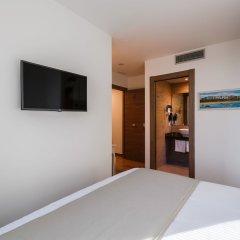 Отель Suite Home Sardinero сейф в номере