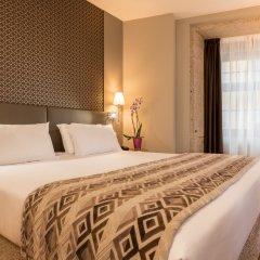 Отель Exe Almada Porto Порту комната для гостей фото 2