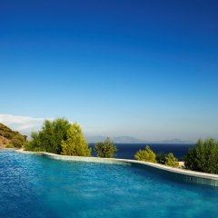 Отель Mitsis Family Village Beach Hotel Греция, Нисирос - отзывы, цены и фото номеров - забронировать отель Mitsis Family Village Beach Hotel онлайн бассейн фото 3