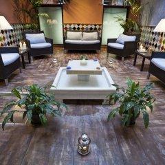 Отель Suites Gran Via 44 Apartahotel интерьер отеля