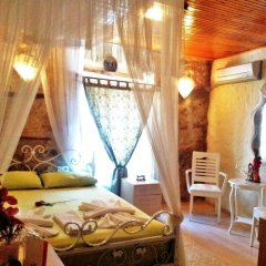 Отель Imerek Tas Ev Otel Чешме комната для гостей фото 2