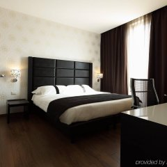 Отель Holiday Inn Genoa City Генуя комната для гостей фото 4