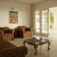 Отель Beachcomber Club Resort Ямайка, Саванна-Ла-Мар - отзывы, цены и фото номеров - забронировать отель Beachcomber Club Resort онлайн интерьер отеля