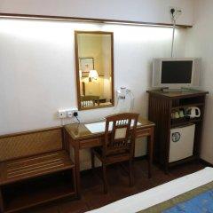 Perak Hotel удобства в номере