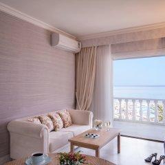 Отель Mitsis Rinela Beach Resort & Spa - All Inclusive комната для гостей фото 3