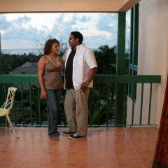 Отель The Cardiff Hotel & Spa Ямайка, Ранавей-Бей - отзывы, цены и фото номеров - забронировать отель The Cardiff Hotel & Spa онлайн балкон