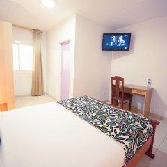 Отель L'Adagio Габон, Либревиль - отзывы, цены и фото номеров - забронировать отель L'Adagio онлайн комната для гостей фото 2