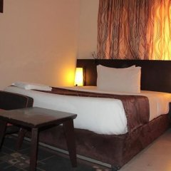 Отель Lakeem Suites Adebola комната для гостей