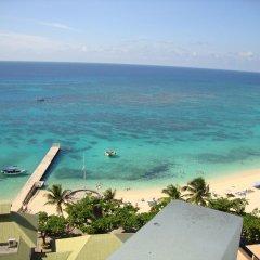 Отель Sky Box Beach Suite at Montego Bay Club Ямайка, Монтего-Бей - отзывы, цены и фото номеров - забронировать отель Sky Box Beach Suite at Montego Bay Club онлайн пляж