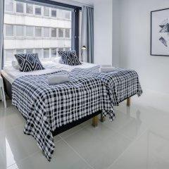 Апартаменты Kotimaailma Apartments Albertinkatu 27B комната для гостей фото 2