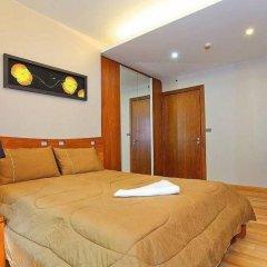 Апартаменты Ocean Fringe Apartment A Паттайя комната для гостей фото 2