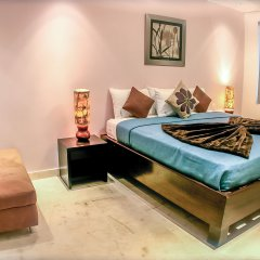 The Elements Oceanfront & Beachside Condo Hotel Плая-дель-Кармен комната для гостей