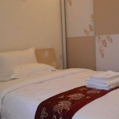 Апартаменты Shengang Apartment Taoyuan Branch комната для гостей фото 2