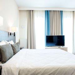 Апарт-Отель Рамада Жуковка Новосибирск комната для гостей