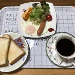 Отель Minshuku Kaisei 1 Якусима в номере