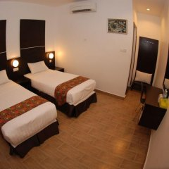 Отель Sipadan Inn 2 удобства в номере