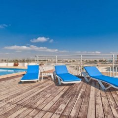 Апартаменты El Lago Apartments бассейн