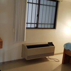 Отель HANA House сейф в номере