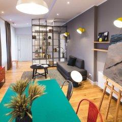 Отель Riga Lux Apartments - Skolas Латвия, Рига - 1 отзыв об отеле, цены и фото номеров - забронировать отель Riga Lux Apartments - Skolas онлайн комната для гостей