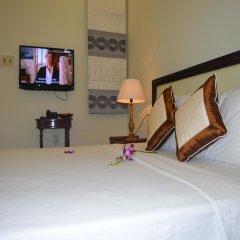 Отель Orchids Homestay удобства в номере фото 2