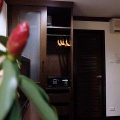 Отель Lanta Mermaid Boutique House Ланта сейф в номере