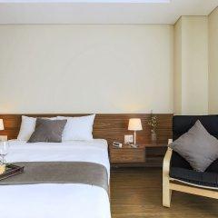 Отель Aurora Serviced Apartments - Adults Only Вьетнам, Хошимин - отзывы, цены и фото номеров - забронировать отель Aurora Serviced Apartments - Adults Only онлайн комната для гостей фото 4