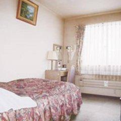 Отель Business Hotel Motonakano Япония, Томакомай - отзывы, цены и фото номеров - забронировать отель Business Hotel Motonakano онлайн комната для гостей фото 2