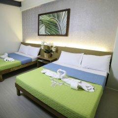 Отель Makati International Inns Филиппины, Макати - 1 отзыв об отеле, цены и фото номеров - забронировать отель Makati International Inns онлайн комната для гостей фото 2