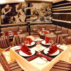 Отель Al Liwan Suites питание фото 3