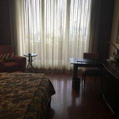Отель The LaLiT Mumbai удобства в номере фото 2