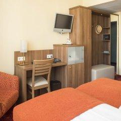 Отель Schlicker - Zum Goldenen Löwen Мюнхен удобства в номере