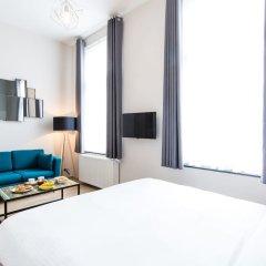 Отель Urban Suites Brussels Schuman Брюссель комната для гостей фото 2