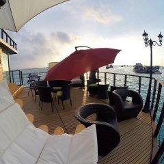 Отель UI Inn Мальдивы, Хулхумале - 1 отзыв об отеле, цены и фото номеров - забронировать отель UI Inn онлайн приотельная территория