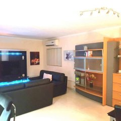 Апартаменты Bencini Apartments комната для гостей