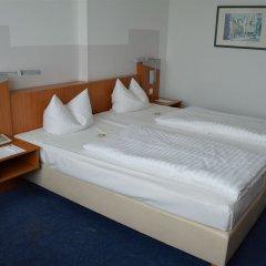 Отель Ramada by Wyndham Hannover Германия, Ганновер - отзывы, цены и фото номеров - забронировать отель Ramada by Wyndham Hannover онлайн комната для гостей фото 4