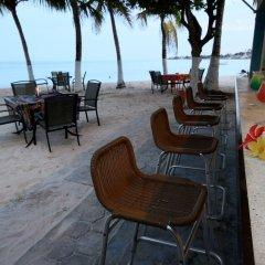 Отель Cocoplum Beach Колумбия, Сан-Луис - 1 отзыв об отеле, цены и фото номеров - забронировать отель Cocoplum Beach онлайн гостиничный бар