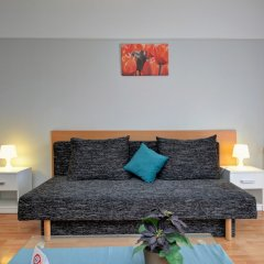 Апартаменты Agape Apartments комната для гостей фото 13