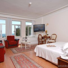 Ada Hotel комната для гостей