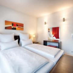 Leonardo Hotel München City West комната для гостей