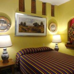 Отель Casa de las Flores Мексика, Тлакуепакуе - отзывы, цены и фото номеров - забронировать отель Casa de las Flores онлайн удобства в номере