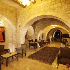 Отель Kayakapi Premium Caves Cappadocia интерьер отеля фото 2