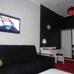Гостиница Астрал (комплекс А) в Тихвине отзывы, цены и фото номеров - забронировать гостиницу Астрал (комплекс А) онлайн Тихвин комната для гостей фото 4